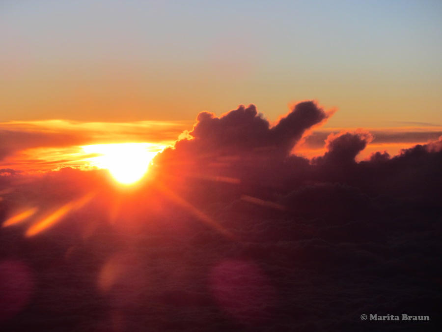 above the clouds sunset